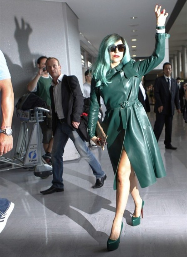 WTFSG-singer-lady-gaga-gestures-at-the-media-upon-her-arrival-at-narita-airport