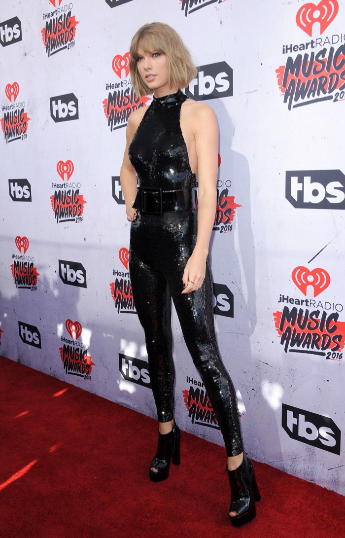 WTFSG_Taylor-Swift-Black-Sequin-Saint-Laurent-Jumpsuit-iHeart-Radio-2016_1