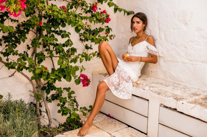 """33d159800f Majorelle White Oak Dress  228 """"Open shoulder styling allows for a sultry  feel while allover lace in a floral motif falls into an almost-sheer panel  for ..."""