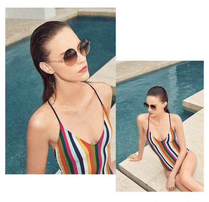 6714c40c11d9f Victoria Beckham Feather Light Round Sunglasses and Tory Burch Feliz Stripe  One Piece Swimsuit