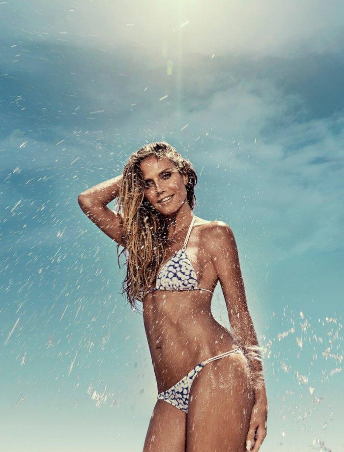 e3fbfb1309 Heidi Klum Stuns at the Beach in New Swimwear Campaign - Wardrobe ...